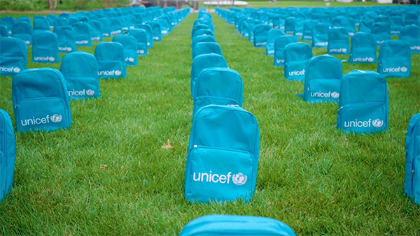Rows of Unicef backpacks laid out like gravestones
